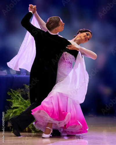 Canvas Print A elegant ballroom couple strikes a pose on the dance floor