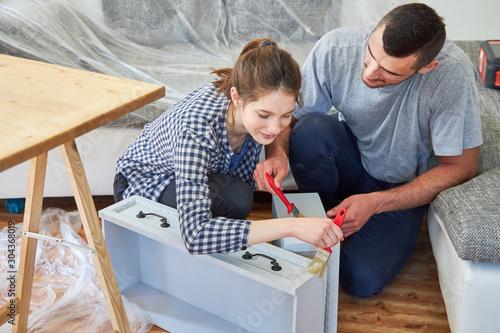 Handyman renovating drawers