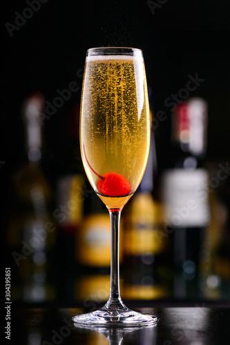 Obraz na plátně sparkling wine cocktail with cherry