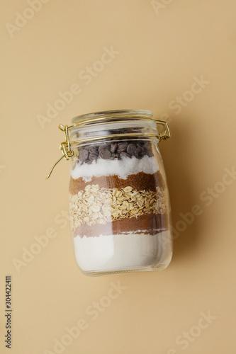Slika na platnu Chocolate chips cookie mix in glass jar
