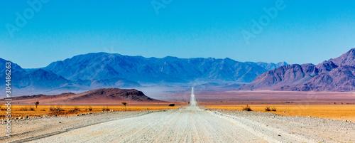 Leinwand Poster Gravel road in Namibia - panorama - Africa