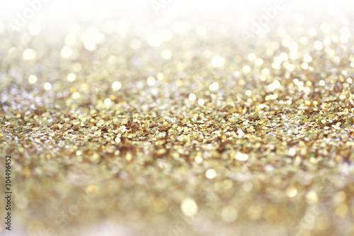 Gold (bronze) glitter shine dots confetti. Abstract light blur blink sparkle ...