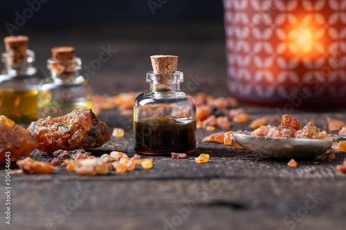 Photo A bottle of myrrh essential oil with myrrh resin