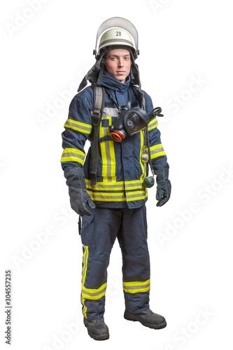 Canvas Print Young fireman with a mask and an air pack on his back