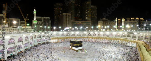 Muslim Pilgrims at The Kaaba in The Haram Mosque of Mecca , Saudi Arabia, In the night during Hajj.