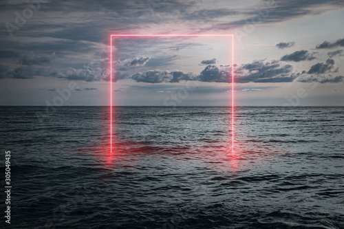 View of the calm sea in the evening, a neon frame emerging from the water, futur Fototapeta