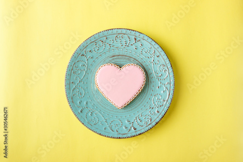 Pink cookie heart shaped with different patterns, yellow background