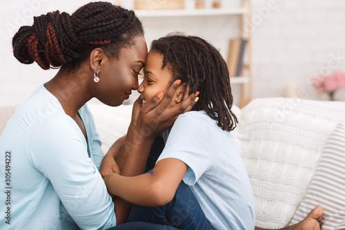 Fototapeta Loving african mom spending time with child