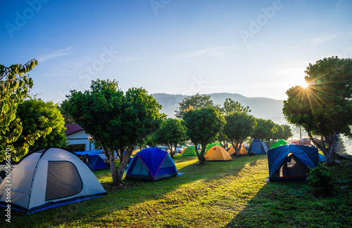 Camping and tent in nature park with sunrise Poster Mural XXL
