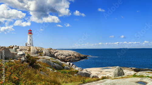 Fotografiet Panorama of harbor with Nova Scotia's iconic Peggys Cove Lighthouse on a sunny d