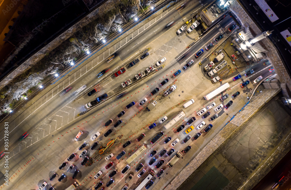 Birds eye view of the entrance in Lincoln Tunnel in Weehawken, NJ at night. The Lincoln Tunnel is a 1.5 mi long tunnel under the Hudson River, connecting Weehawken, NJ with Midtown Manhattan in NYC. <span>plik: #305728431 | autor: mandritoiu</span>