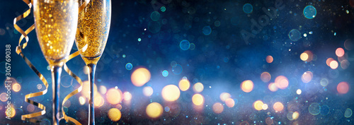 Fotografering Abstract Celebration With Champagne - Flutes With Defocused Christmas Lights In
