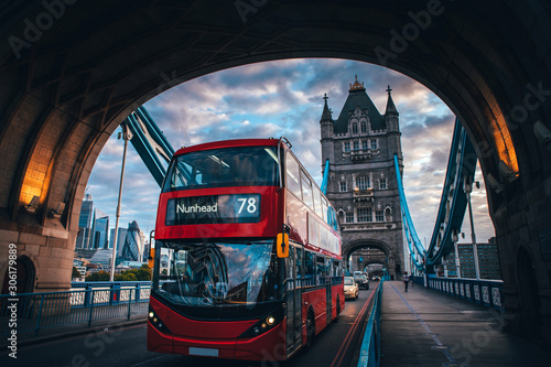 Fotografiet Red double decker bus at the Tower Bridge in London