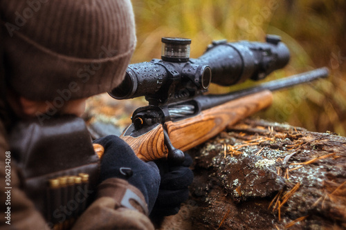 Fototapeta a rifle with a telescopic sight. hunting in the forest