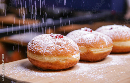Fotografia Hanukkah food doughnuts with jelly and sugar powder with bookeh background