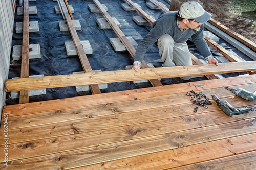 Leinwand Poster Constructing a Wooden Flooring of a Terrace, Douglas Fir