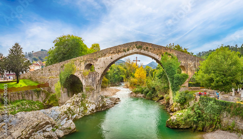 Roman hump-backed bridge on the Sella River in Cangas de Onis, Asturias, Spain