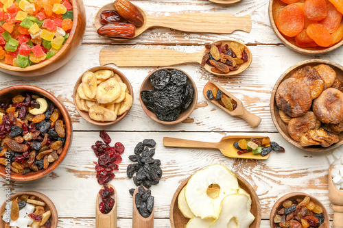 Fotografia, Obraz Different dried fruits on white wooden background