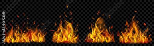 Valokuva Set of translucent burning campfires of flames and sparks on transparent background