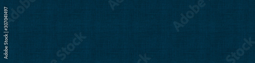 Close up texture of natural weave cloth in dark blue or teal color. Fabric texture of natural cotton or linen textile material. Seamless background.