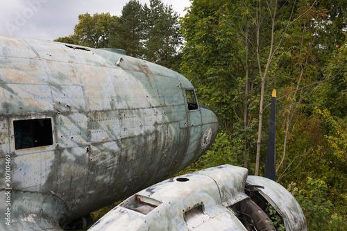 Fotografie, Obraz Damaged Douglas C-47b Dakota military airplane at abandoned military airfield Ze