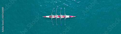 Tableau sur Toile Aerial drone top panoramic view of sport canoe rowing synchronous athletes compe