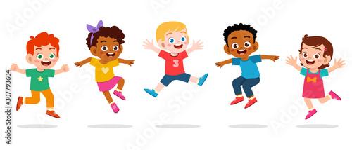 happy cute kids boy and girl jump