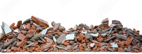 Fotografia Pieces of concrete and brick rubble debris on building in civil war isolated on