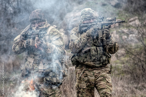 Obraz na plátne military soldiers attacking enemies trough smoke screen