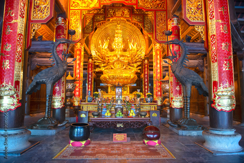 Stampa su Tela Golden Buddha Statue in the Bai Dinh Pagoda temple complex, Trang An, popular at