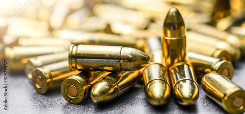 Canvastavla Bullets ammunition on stone table wide banner or panorama