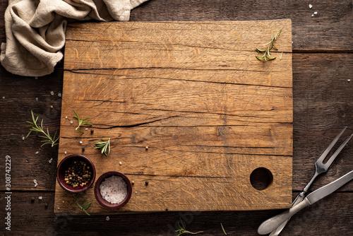 Fotografía Chopping board on dark, wooden table