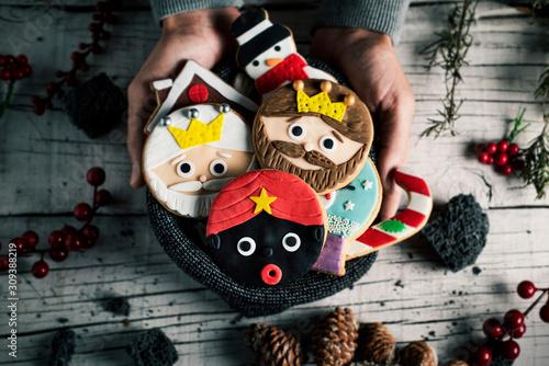 man with christmas cookies in his hands Fototapeta