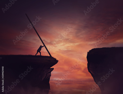Businessman pushing a long beam, creating an improvised bridge to cross the abyss obstacle Fotobehang