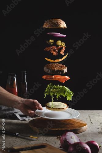Burger ingredients above plate