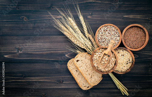Various natural organic cereal and whole grains seed in wooden bowl for healthy food ingredient product concept Fototapeta