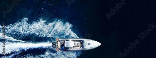 Stampa su Tela Aerial drone ultra wide top down photo of luxury rigid inflatable speed boat cru