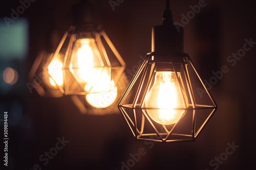 Fotografia Lightning lamps at home, in restaurant or cafe: Close up of a hanging, orange li