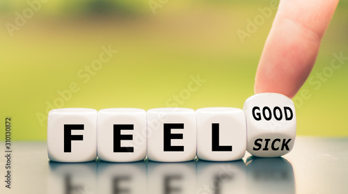 Canvastavla Hand turns a dice and changes the expression feel sick to feel good