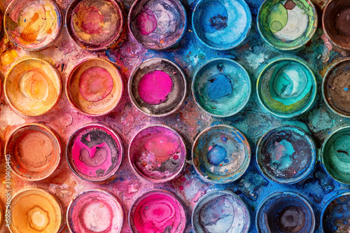 Photo Closeup of used watercolor palette - beautiful vivid colors