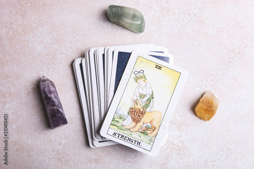 Photo Fortune-telling tarot cards and mineral stones