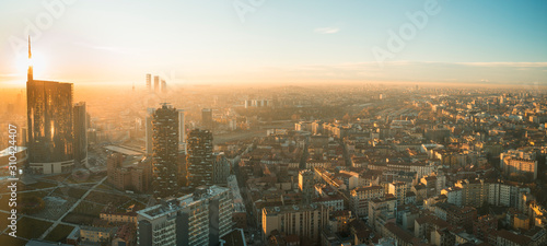 Milan cityscape at sunset, panoramic view with new skyscrapers in Porta Nuova district. Italian landscape.
