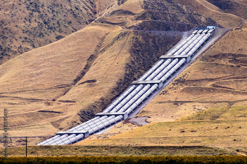 Fototapeta Aqueducts at the south end of San Joaquin Valley, taking pumped water uphill, ov
