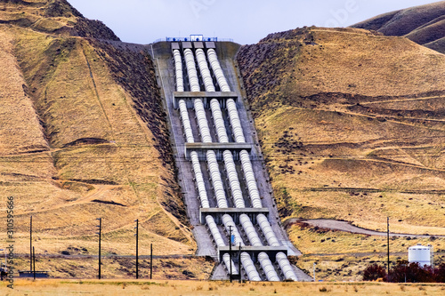 Wallpaper Mural Aqueducts at the south end of San Joaquin Valley, taking pumped water uphill, ov