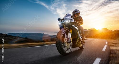 Fotografiet motorbike on the coastal road riding