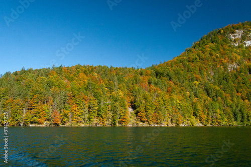 reflection of hills in koenigsee, autumn time in Bavaria, Germanhy