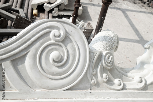 Платно a beautiful decorative detail of stucco in the Indian temple under construction