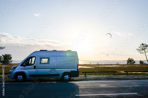 Canvas campervan by the sea in summer concept of vanlife in french coast Lacanau lake
