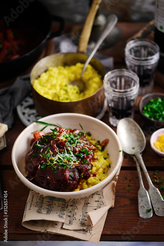 Canvas Print Ossobucco with Milanese risotto.style rustic.