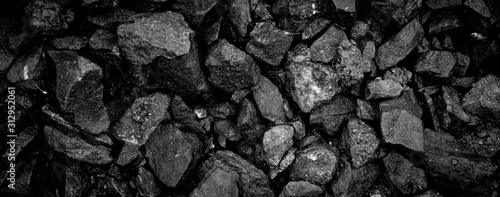 Photo A heap of black natural coal, photo of coal mine background, texture